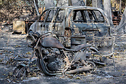 Destroyed car amd motocycle near home. The Woolsey wildfire started on November 8, 2018 and has burned over 98,000 acres of land, destroyed an estimated 1,100 structures and killed 3 people in Los Angeles and Ventura counties and the especially hard hit area of Malibu. California, USA