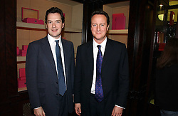 Left to right, GEORGE OSBORNE MP and DAVID CAMERON MP leader of the Conservative party  at a party to celebrate the 10th anniversary of the Smythson Fashion Diary and to the launch of the 2007 Limited Edition held at Smythson, New Bond Street, London on 25th October 2006.<br /><br />NON EXCLUSIVE - WORLD RIGHTS