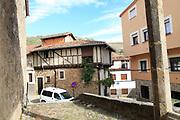 Traditional houses and modern homes architecture narrow street, Garganta la Olla, La Vera, Extremadura, Spain