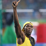 Athletics - Olympics: Day 9  Usain Bolt of Jamaica celebrates after winning the Men's 100m Final at the Olympic Stadium on August 14, 2016 in Rio de Janeiro, Brazil. (Photo by Tim Clayton/Corbis via Getty Images)