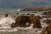 Arched rock at Coleman Beach on Highway 1 in Sonoma County, California USA