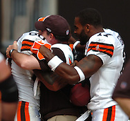 MORNING JOURNAL/DAVID RICHARD.Cleveland tight end Kellen Winslow, left, hugs head trainer Marty Lauzon, center, who spent countless hours in rehab with the tight end. Also celebrating the score is Braylon Edwards.