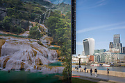Mexico's Agua Azul Waterfalls appears on a large ad for Mexican tourism, with the City of London architecture on the northern side of the River Thames.
