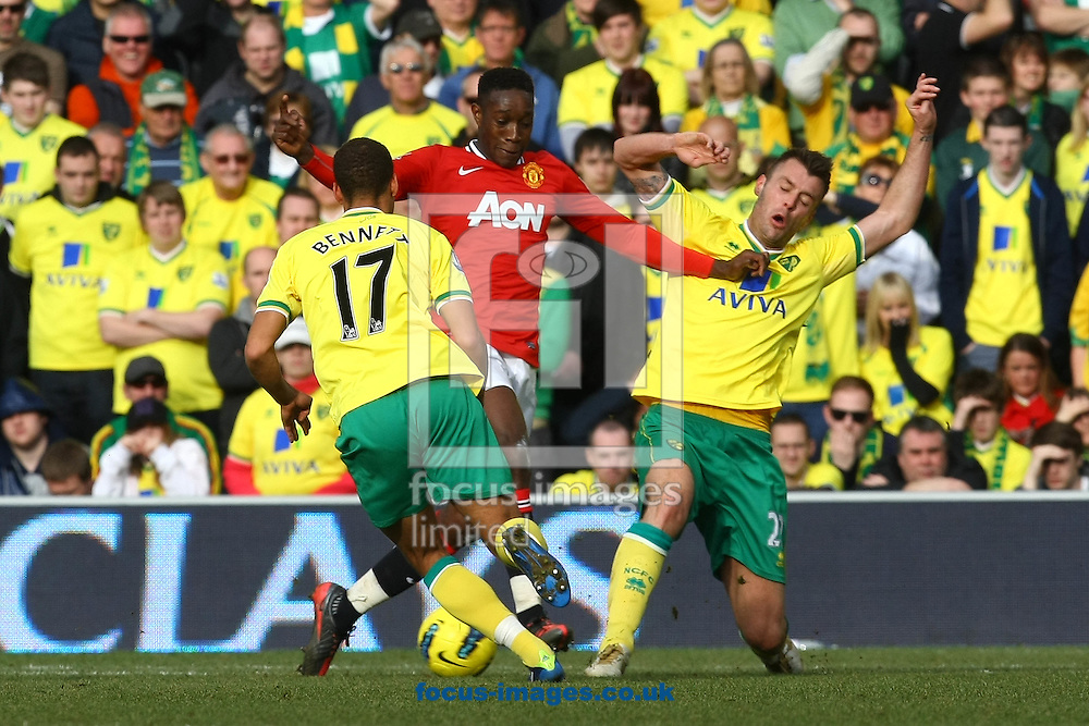 Picture by Paul Chesterton/Focus Images Ltd.  07904 640267.26/02/12.Danny Welbeck of Man Utd and Elliott Bennett of Norwich and Elliot Ward of Norwich in action during the Barclays Premier League match at Carrow Road Stadium, Norwich.