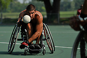 Tony Shaw, 36, shovels the ball off to first base during practice with central Ohio's only wheelchair softball team at Rhodes Park on August 14, 2010.