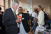 William Nolens of the Rural Energy Foundation for Sub Saharan Africa  explains what his organisation does to a guest at the drinks reception.