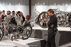 Josh Kurpius checks out Christian Newman's Knucklehead at the Old Iron - Young Blood exhibition media and industry reception in the Motorcycles as Art gallery at the Buffalo Chip during the annual Sturgis Black Hills Motorcycle Rally. Sturgis, SD. USA. Sunday August 6, 2017. Photography ©2017 Michael Lichter.