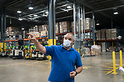 Distribution Manager Omar Jarrar describes the impact that the COVID-19 pandemic has had on the volume of food Second Harvest Heartland stores and delivers in Brooklyn Park, Minnesota, U.S., on Thursday, July 23, 2020. Photographer: Ben Brewer/Bloomberg