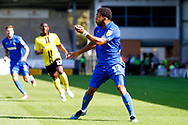Wimbledon midfielder Andy Barcham (17) heads the ball back across the area during the EFL Sky Bet League 1 match between Burton Albion and AFC Wimbledon at the Pirelli Stadium, Burton upon Trent, England on 1 September 2018.