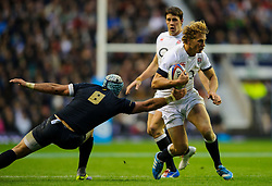 England Inside Centre (#12) Billy Twelvetrees (Gloucester Rugby)  is tackled by Argentina Number 8 (#8) Juan Manuel Leguizamon (Lyon) during the first half of the match - Photo mandatory by-line: Rogan Thomson/JMP - Tel: Mobile: 07966 386802 09/11/2013 - SPORT - RUGBY UNION -  Twickenham Stadium, London - England v Argentina - QBE Autumn Internationals.