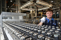 Peggy Van Sande, a Philips' technician, makes sure the glass tubes meet strict specifications, before being moved on to the next stage in the production of CosmoPolis Metal Halide lamps, at the Philips Lighting factory, in Turnhout, Belgium, on Friday, Oct. 15, 2010. (Photo © Jock Fistick)