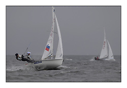 470 Class European Championships Largs - Day 2.Wet and Windy Racing in grey conditions on the Clyde...SLO64, Tina MRAK, Teja CERNE, Jk Pirat Portoroz ...