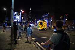 June 3, 2017 - London, London, UK - London, UK. Police deal with an ongoing incident at London Bridge. A white van is reported to have veered off the road and hit a number of pedestrians. (Credit Image: © Rob Pinney/London News Pictures via ZUMA Wire)