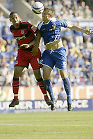 Photo: Aidan Ellis.<br /> Leicester City v Queens Park Rangers. Coca Cola Championship. 15/09/2007.<br /> Leicester's Garteh McAulley wins the header from QPR's Dexter Blackstock