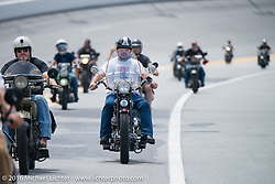 Brent Mayfield and other Motorcycle Cannonball riders ride the Daytona Speedway on Thursday before the Friday start of the Motorcycle Cannonball Cross-Country Endurance Run. Daytona Beach, FL, USA. September 4, 2014.  Photography ©2014 Michael Lichter.