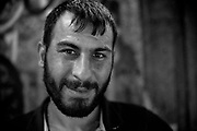 Melik Hama Black and white portrait of an informal rubbish collector in Istanbul Turkey. <br /> In Turkey, there are estimated to be as many as 500,000 waste pickers (toplayıcılar): Those making a living via the collection of recyclables off the street and from waste bins. <br /> The Ankara-based Street Waste Collectors Association (Sokak Atık Toplayıcıları Derneği) is demanding the creation of a legislation recognizing waste picking as a formal profession.<br /> John Wreford is a freelance professional photographer based in Turkey