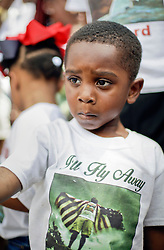 29 August 2015. Lower 9th Ward, New Orleans, Louisiana.<br /> Hurricane Katrina 10th anniversary memorials.  <br /> Carmello Hurst (4yrs) dances in a second line parade to remember those who perished in the storm.<br /> Photo credit©; Charlie Varley/varleypix.com.