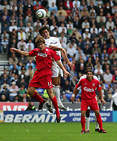 Photo. Andrew Unwin.<br /> Bolton Wanderers v Liverpool, Barclays Premiership, Reebok Stadium, Bolton 29/08/2004.<br /> Bolton's Ivan Campo outjumps Liverpool's new signing, Xabier Alonso (14)<br /> NORWAY ONLY