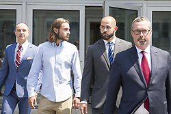 August 2, 2017 - Toronto, ON, Canada - OSHAWA, ON - AUGUST 2  -   .(l-r) David Butt, lawyer for Christian Theriault, Christian Theriault, Const. Michael Theriault and his lawyer Michael Lacy. OSHAWA, ON - AUGUST 2  -   Const. Michael Theriault (right) and his brother, Christian Theriault leave Durham Region Courthouse in Oshawa, following and appearance in relation to the beating of Dafonte Miller on August 2, 2017.They are charged with public mischief in addition to aggravated assault and assault with a weapon in connection with the Dec. 28 beating of Dafonte Miller in Whitby.  August 2, 2017. Carlos Osorio/Toronto Star (Credit Image: © Carlos Osorio/The Toronto Star via ZUMA Wire)