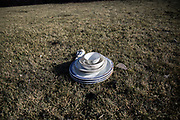 Burned dishes left on the backyard of one of the house on Foothill Blvd in Ventura, California. Entire neighborhood include this house burned by the wildfire occurred in Ventura area. On Saturday, December 9th, 2017 at Ventura, California. (Photo by Yuki Iwamura)
