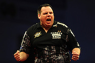 Adrian Lewis in action on his way to a  7-5 win against Robert Thornton. McCoy's Premier league darts, week 7 event at the Motorpoint Arena in Cardiff, South Wales on Thursday 21st March 2013. pic by Andrew Orchard, Andrew Orchard sports photography,