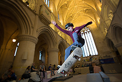 "© Licensed to London News Pictures 15/02/2017, Malmesbury, UK. The ""Malmesbury Abbey Skate"" now in its's 9th year, where the interior of the 12th century abbey in Malmesbury, Wiltshire is turned into a skate park for 3 days during the February half term. Pictured here: 14 year old Sam Vugts getting ""some air"".<br /> Photo Credit : Stephen Shepherd/LNP"