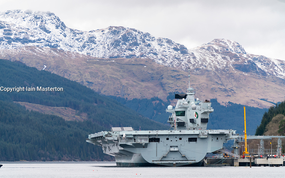 Finnart, Scotland, UK. 15 March 2021. Royal Navy aircraft carrier HMS Queen Elizabeth berthed on Long Loch  at Glenmallon to take on supplies and munitions ahead of naval exercises part of UK Carrier Strike Group 2021.  Iain Masterton/Alamy Live News