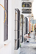 A man reads a book in the Barrio Antiguo or Spanish Quarter neighborhood adjacent to the Macroplaza Grand Plaza in Monterrey, Nuevo Leon, Mexico.