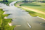 Nederland, Gelderland, Neder-Rijn, 28-06-2006; luchtfoto (25% toeslag binnenvaartschepen voeren stroomopwaarts; aan de horizon de IJsselkop; op deze plek buigt de Neder-Rijn af naar links, richting Arnhem, de IJssel (rechts) begint op dit punt (en is dus een afspliting van de Rijn de IJssel is gekanaliseerd, de Rijnoevers hebben kribben i.v.m. bevaarbaarheid van de rivier, het voorkomen van afzetting van sediment; binnenvaart, beroepsvaart, rijnaak, verkeer en vervoer, scheepvaart, waterbeheer.luchtfoto (toeslag aerial photo (additional fee required .foto Siebe Swart / photo Siebe Swart