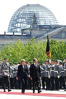 14 JUN 2006, BERLIN/GERMANY:<br /> Angela Merkel (L), CDU, Bundeskanzlerin, und Romano Prodi (R), Ministerpraesident Italien, waehrend dem Abschreiten der Ehrenformation des Wachbatailons der Bundeswehr, Begruessung mit militaerischen Ehren, Ehrenhof, Bundeskanzleramt<br /> IMAGE: 20060614-01-015