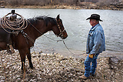 """CREDIT: Steven St. John for The Wall Street Journal<br /> """"ANIMAS""""<br /> <br /> Rancher Lin Blancett, whose cows had to be evacuated because of the Gold King Mine spill, stands along the Animas River on Tuesday, March 22, 2016"""