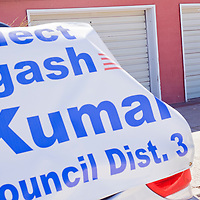 031213       Cable Hoover<br /> <br /> District 3 city council candidate Yogash Kumar stands behind a large campaign banner outside the polling station at Red Rock Elementary School in Gallup Tuesday.