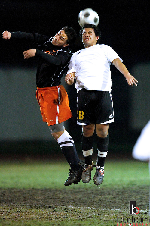 Antioch High's Rene Gonsalez, right,  and Pittsburg High's Bryan Santos go up for a ball during their game at Antioch High School on Tuesday, Feb. 7, 2012. (Photo by Kevin Bartram)