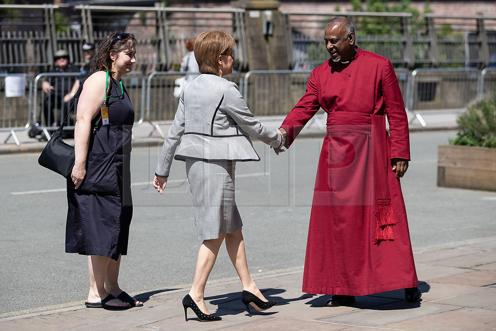© Licensed to London News Pictures . 22/05/2018 . Manchester , UK . NICOLA STURGEON arrives and is greeted by Dean ROGERS GOVENDER at Manchester Cathedral for a Service of Remembrance on the first anniversary of the Manchester Arena bombing . On the evening of 22nd May 2017 , Salman Abedi murdered 22 people and seriously injured dozens more , when he exploded a bomb in the  foyer of the Manchester Arena as concert-goers were leaving an Ariana Grande gig . Photo credit : Joel Goodman/LNP