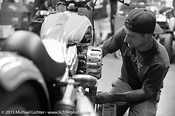 Steven Blalock helping with final prep on Scott Jones' bike at Noise Cycles the night before Born Free 6. Santa Ana, CA. USA. June 26, 2014.  Photography ©2014 Michael Lichter.
