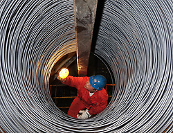 DALIAN, May 1, 2017 -Dalian, China -  Inspector CUI LIFENG examines surface of stainless steel wire at Dalian Special Steel Co., Ltd. in Dalian, northeast China's Liaoning Province.  (Credit Image: © Liu Debin/Xinhua via ZUMA Wire)