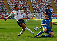 Photo: Glyn Thomas.<br />England v Paraguay. Group B, FIFA World Cup 2006. 10/06/2006.<br /> England's man of the match Frank Lampard (L) shoots.