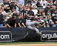 CHICAGO - APRIL 5:  Jhonny Peralta #2 of the Cleveland Indians falls into the stands to make a catch against the Chicago White Sox on April 5, 2010 at U.S. Cellular Field in Chicago, Illinois.  The White Sox defeated the Indians 6-0.  (Photo by Ron Vesely)