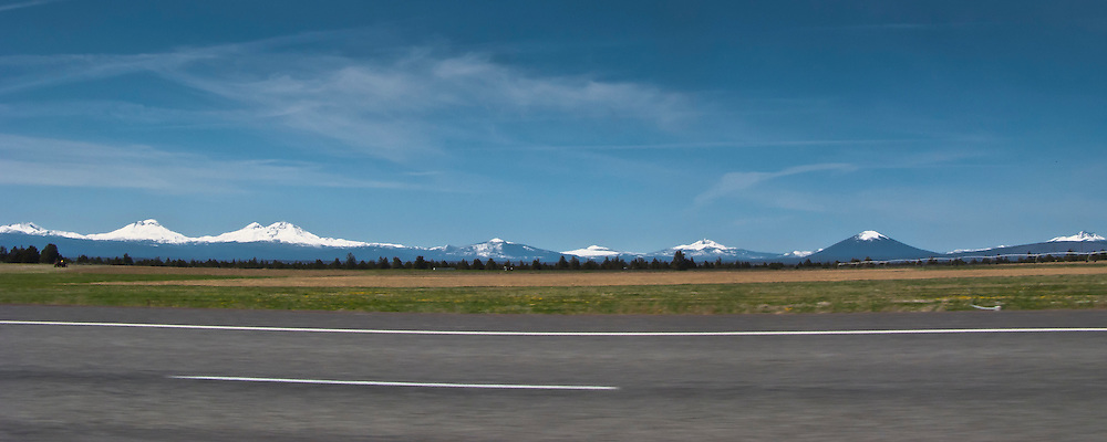 scene along a cross country trip with in a classic Mini Cooper auto - volcanos of the Oregon Cascade Range viewed from US 97