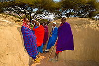 Maasai tribe outside one of their huts, Manyatta village, Ngorongoro Conservation Area, Tanzania