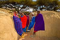Maasai tribe outside one of their huts, Manyatta village, Ngorongoro Conservation Area, Tanzania