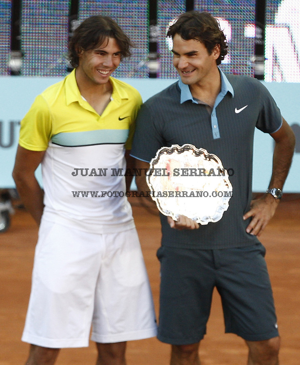 17 May 2009, Madrid --- Roger Federer (R) of Switzerland and Rafael Nadal of Spain smile on the podium at the end of the men singles final match during the ATP 1000 Mutua Madrilena Madrid Open at the Magic Box stadium in Madrid, Spain. Photo byJuan Manuel Serrano --- Image by ©Juan Manuel Serrano