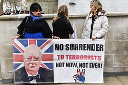 Members of Pergida (Patriotic Europeans against the Islamisation of the West) hold a placard as they hold a rally in Whitehall. Feb 2016 UK