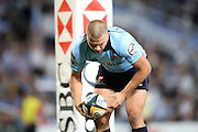 Waratahs winger Drew Mitchell places the ball to score a try. Super 14 Rugby Union, Waratahs v Lions, Sydney Football Stadium, Australia. Friday 12 March 2010. Photo: Clay Cross/PHOTOSPORT