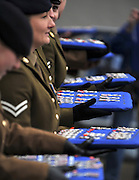 © under license to London News Pictures. 08/12/2010. Members of the regiment hold trays containing the medals. 12 Logistic Support Regiment The Royal Logistic Corp (12 LSR), based in Abingdon, Oxon and Gutersloh, Germany, march through the centre of Abingdon after being awarded with their Afghanistan Campaign Medals. Members of the public and the soildiers families turned out in the cold weather to cheer the men and women on. Photo credit should read: Stephen Simpson/LNP
