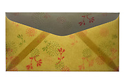 an open letter envelope with ornamental flower decoration