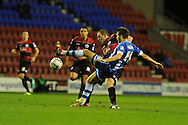Wigan's Nick Powell is fouled by QPR's Richard Dunne late on but the ref waves play on. Skybet championship match, Wigan Athletic  v Queens Park Rangers at the DW Stadium in Wigan, Lancs on Wed 30th Oct 2013. pic by Andrew Orchard, Andrew Orchard sports photography,