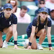 LONDON, ENGLAND - JULY 12:  Ball girls' in action on Court One during the Wimbledon Lawn Tennis Championships at the All England Lawn Tennis and Croquet Club at Wimbledon on July 12, 2017 in London, England. (Photo by Tim Clayton/Corbis via Getty Images)