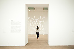 """Mira Schendel at Tate Modern in London. <br /> Tate Modern employee poses next to works entitled """"Variants 1977"""" by Mira Schendel, Tate Modern, London, Tuesday, 24th September 2013. Picture by Piero Cruciatti / i-Images"""