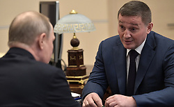 April 13, 2018 - Moscow Region, Russia - April 13, 2018. - Russia, Moscow Region, Novo-Ogaryovo. - Russian President Vladimir Putin and Governor of the Volgograd Region Andrey Bocharov (right) during their meeting. (Credit Image: © Russian Look via ZUMA Wire)